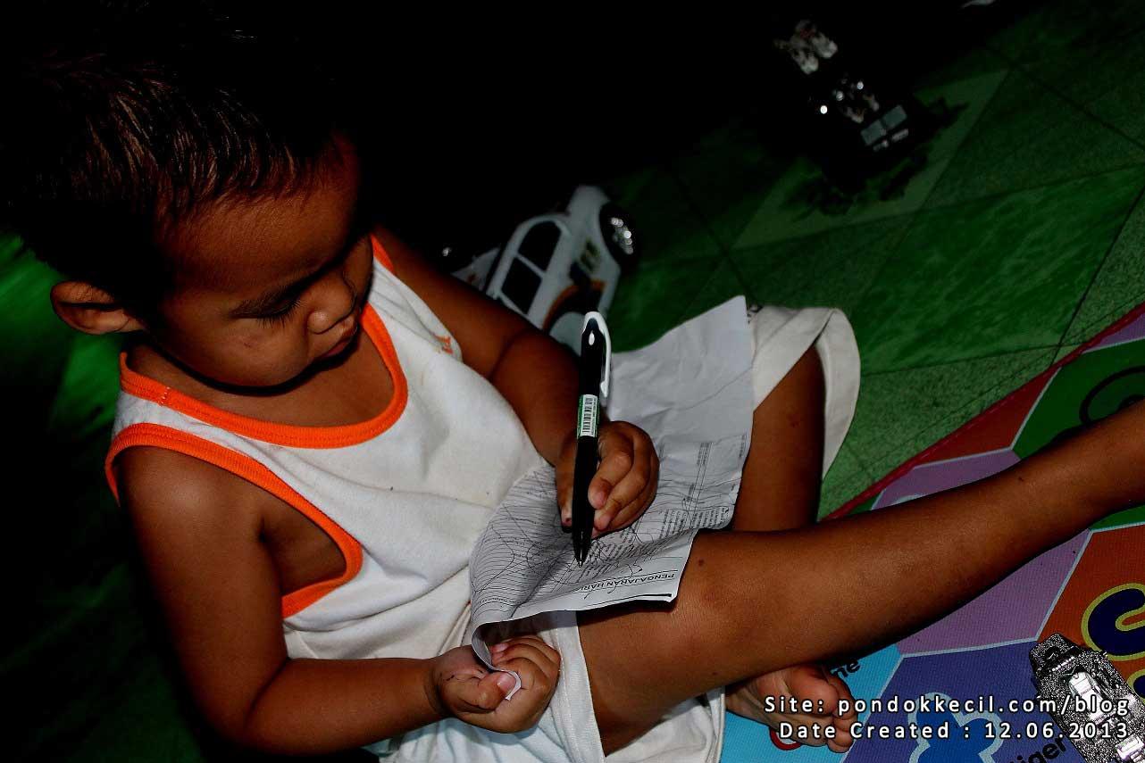 anak pandai menulis